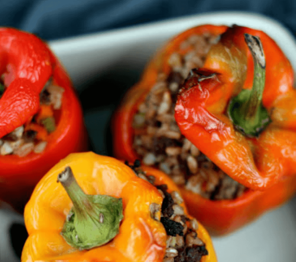 3 peppers stuffed with rice and meat