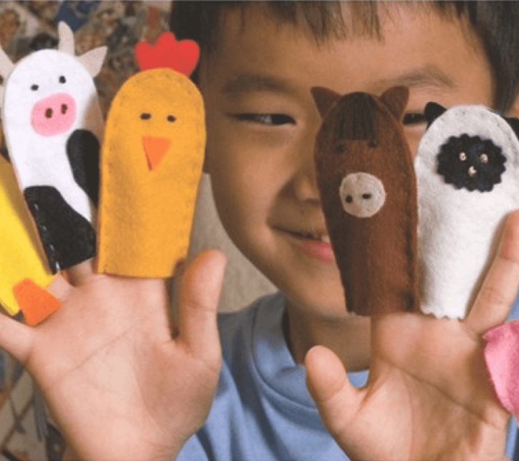 a young child with finger puppets
