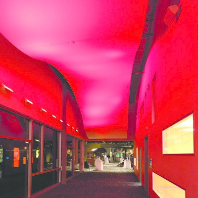 a hallway with red interactive lights