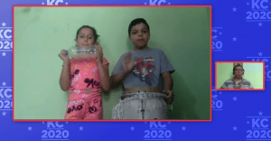 children on a video conference playing instruments