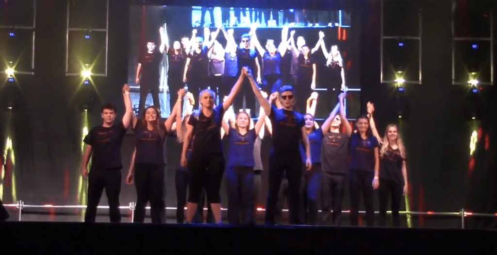 theatre performers wearing black and bowing