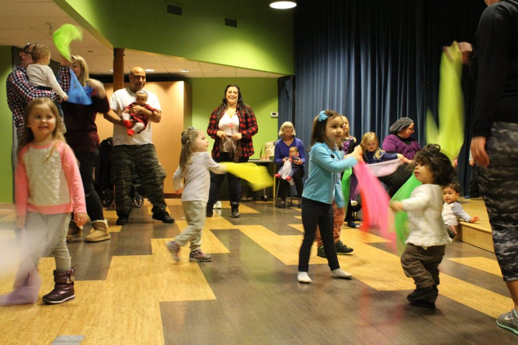 a group of children and parents dancing