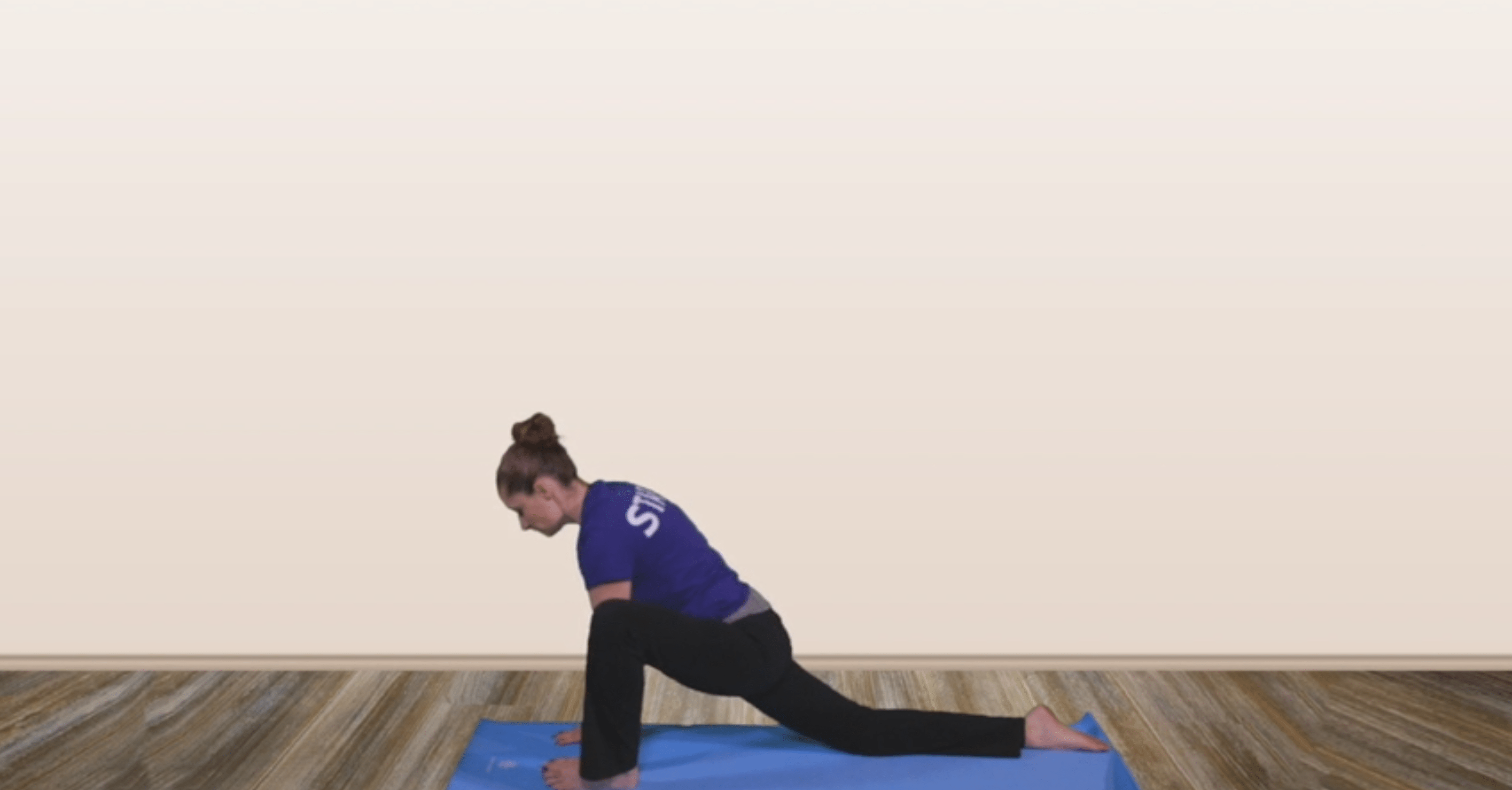 a yoga instructor teaching yoga through video conference